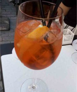 https://cocktailsandshots.com/wp-content/uploads/2018/06/aperol_spritz_cocktail_recipe_made_with_prosecco_aperol_and_soda_water-250x300.jpg