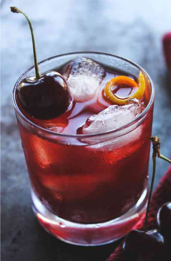 https://cocktailsandshots.com/wp-content/uploads/2018/06/canadian_cherry_cocktail_recipe_made_with_whisky_orange_juice_lemon_juice_and_cherry_liqueur.jpg