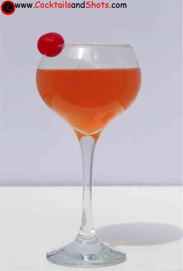 https://cocktailsandshots.com/wp-content/uploads/2018/06/le_triomphe_cocktail_recipe_with_pineapple_grapefruit_grenadine_cognac_grand_marnier_cherry.jpg
