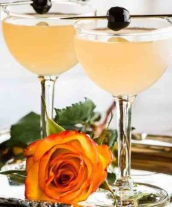 https://cocktailsandshots.com/wp-content/uploads/2018/06/mary_pickford_cocktail_recipe_made_with_white_rum_pineapple_juice_grenadine_and_maraschino-250x300.jpg