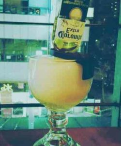 https://cocktailsandshots.com/wp-content/uploads/2018/06/the_best_mexican_bulldog_cocktail_recipe_made_with_corona_tequila_lime_juice_orange_juice_syrup_orange_liqueur-250x300.jpg