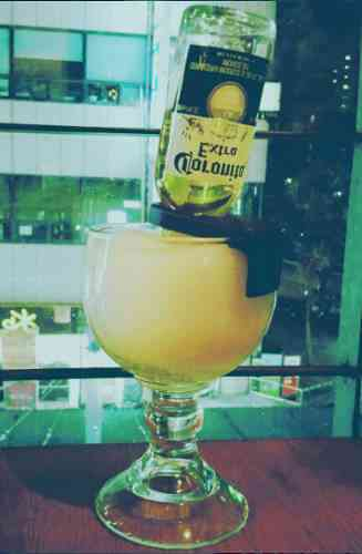 https://cocktailsandshots.com/wp-content/uploads/2018/06/the_best_mexican_bulldog_cocktail_recipe_made_with_corona_tequila_lime_juice_orange_juice_syrup_orange_liqueur.jpg